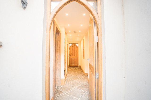 Corridor leading to bathroom, utility room and private courtyard