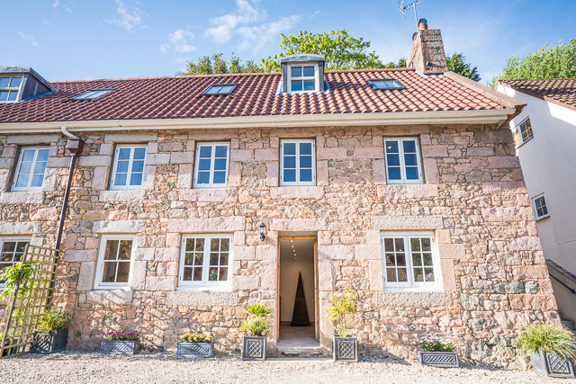 Aubin Cottage is at the end of a terrace of pretty granite cottages