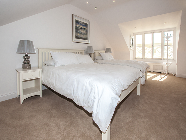Spacious bedroom located on its own floor with double and twin single beds and ensuite