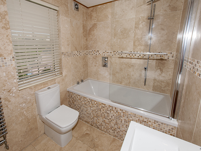 House bathroom with shower over bath