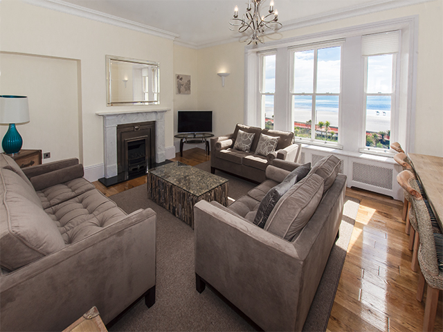 Open plan lounge and dining area with views of St Aubin