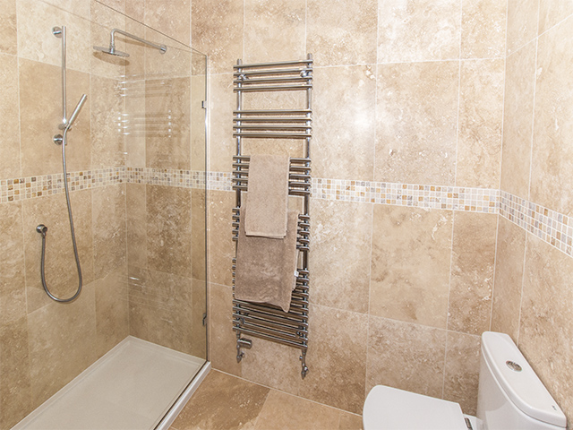 Ensuite with large shower, sink and toilet