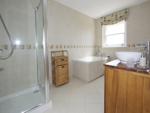 House bathroom with bath and separate shower