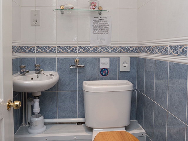 Cloakroom with toilet and basin