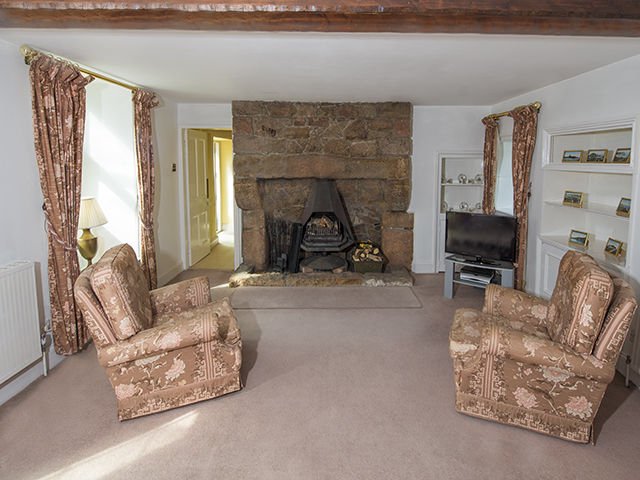 Lounge showing one of the two fireplaces