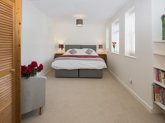 Master bedroom with super king-size bed which can be made up as 2 singles.
